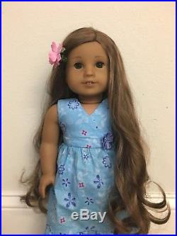 American girl doll Kanani with outfit and chair great condition