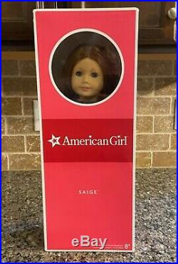 Retired American Girl Doll Saige in original box, ear rings, full outfit